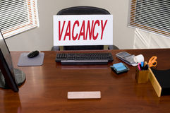 Desk and Vacancy Sign. Desk with a Vacancy sign. Your text in the blank name plate. Great for employment/HR/unemployment themes royalty free stock photos