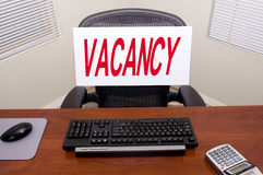 Desk and Vacancy Sign. Desk with a Vacancy sign. Great for employment/unemployment and other HR issues royalty free stock image