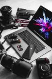 Desk with various gadgets stock image