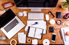 Desk with various gadgets and office supplies. Flat lay Royalty Free Stock Photos