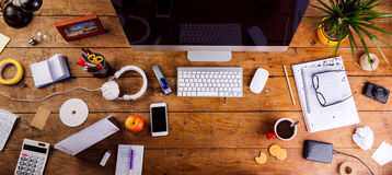 Desk with various gadgets and office supplies. Flat lay Royalty Free Stock Photography