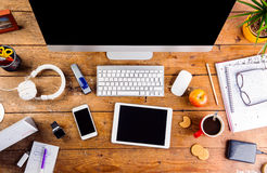 Desk with various gadgets and office supplies. Flat lay Royalty Free Stock Images