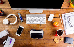 Desk with various gadgets and office supplies. Flat lay Stock Photos