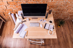 Desk with various gadgets and office supplies. Studio shot. Royalty Free Stock Images