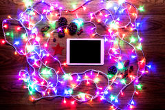 Desk view from above with digital tablet and christmas lights, xmas online shopping Stock Images