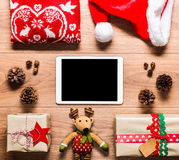 Desk view from above with digital tablet and presents, online shopping Stock Photos