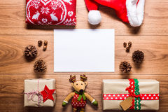 Desk view from above with empty letter to santa and presents, retro xmas concept Stock Photo