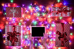 Desk view from above with female hands and digital tablet, xmas online shopping Royalty Free Stock Image
