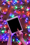 Desk view from above with female hands and digital tablet, xmas online shopping Royalty Free Stock Photography