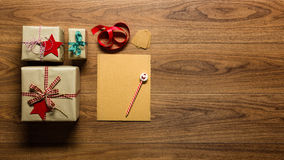 Desk view from above with letter to santa and presents, retro xmas concept Stock Image