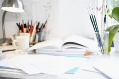 Desk With Books; Papers And Brushes Royalty Free Stock Photos
