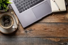 Free Desk With Laptop, Eye Glasses, Notepad, Pen And A Cup Of Coffee On A Old Wooden Table. Top View With Copy Space. Flat Lay. Dark Ba Royalty Free Stock Photo - 123781605