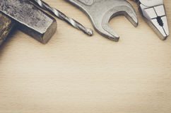 Desk of a wooden with hammer, drill, Pliers, wrench. Desk of a wooden with wrench, hammer, drill, Pliers royalty free stock photo