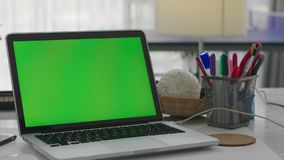 Desk working at home on with laptop green screen stock footage