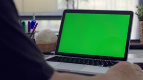 Desk working at home on with laptop green screen stock video footage