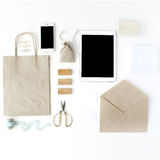 Desk workspace with tablet, phone, craft envelopes Royalty Free Stock Photography