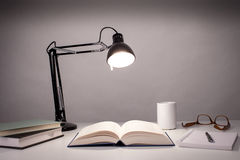 Desk of a writer. Vintage black desk lamp isolated on white Stock Photo