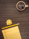 Desk, Yellow Notepad, Pencil, Coffee Cup Royalty Free Stock Photography