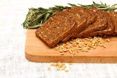 deskowego chlebowego zarazka rozmarynowy pszeniczny drewniany Obraz Royalty Free