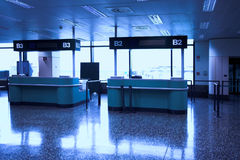 Desks in airport Royalty Free Stock Photos