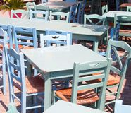 Desks and chairs. Some desks and chairs in a greek tavern stock images