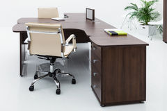 Desks and leather chairs Stock Photography