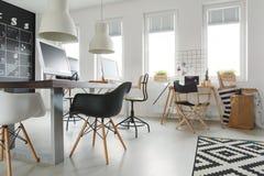 Desks in office. Wooden modern desks in white trendy office stock photo