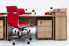 Desks and red armchairs Stock Image