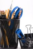 Desktop baskets with pencils and clips. Two baskets on a desktop full of pencils, paper clips and a pair of scissors Royalty Free Stock Photo