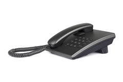 Desktop black phone with rounded buttons. Close-up. Isolated on white background Royalty Free Stock Photo