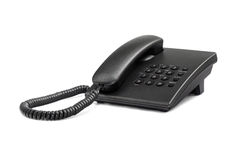 Desktop black phone with rounded buttons. Close-up. Isolated on white background Royalty Free Stock Photos