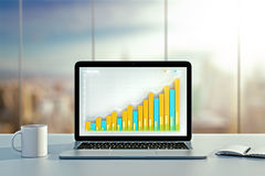 Desktop with business chart, coffee mug and diary Royalty Free Stock Photos