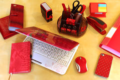 Desktop for Business Lady. Stationery and business accessories in red color scheme Stock Photos