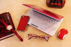 Desktop for Business Lady. Stationery and business accessories in red color scheme Royalty Free Stock Photography