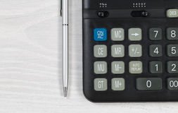 Desktop with Calculator and pen Royalty Free Stock Photo