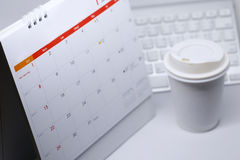 Desktop calendar blank schedule of 1 january 2017. Put on table work office with coffee cup Stock Photography