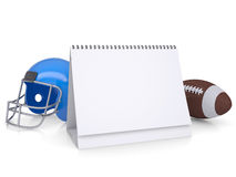 Desktop calendar, a football helmet and ball Royalty Free Stock Images