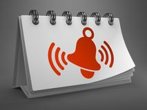 Desktop Calendar with Red Ringing Bell Icon. Royalty Free Stock Photography