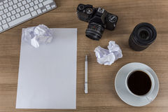 Desktop with camera blank sheet and coffee Royalty Free Stock Photography