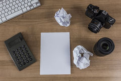 Desktop with camera keyboard and calculator Stock Photography