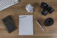 Desktop with camera keyboard and calculator Royalty Free Stock Photography