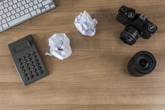 Desktop with camera keyboard and calculator Royalty Free Stock Images