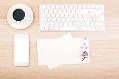 Desktop with cards and phone Royalty Free Stock Photography