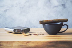Desktop with cigar and flask Stock Photo