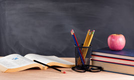 Desktop in classroom ready to learn from textbooks Stock Photo