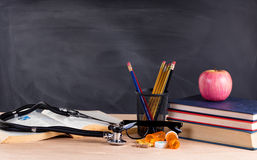Desktop in classroom ready to learn to become a medical doctor Royalty Free Stock Image
