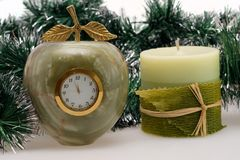 Desktop Clock and candle Stock Photography