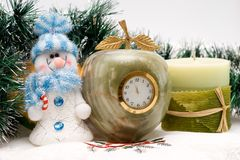 Desktop Clock, candle and snowman Stock Images
