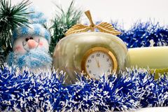 Desktop Clock, candle and snowman Stock Photo