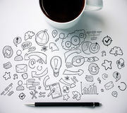 Desktop with coffee cup and business sketch Royalty Free Stock Images